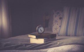 Picture watch, books, bed, alarm clock