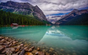 Picture forest, clouds, trees, mountains, lake, stones, shore, boats, pier, Canada, house, Alberta, Lake Louise, Canoeing