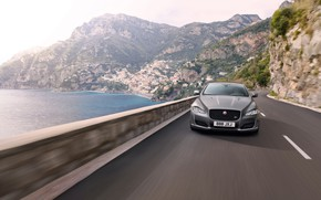 Picture road, sea, mountains, movement, markup, coast, vegetation, Jaguar, the fence, 2017, 575 HP, XJR 575