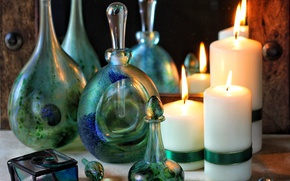 Picture glass, candles, bottle
