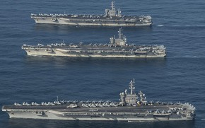 Picture the ocean, Ronald Reagan, Nimitz, Theodore Roosevelt, nuclear aircraft carriers