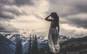 Picture girl, mountains, clouds, the wind, Still Standing