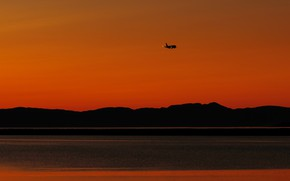 Picture sea, the sky, sunset, the plane