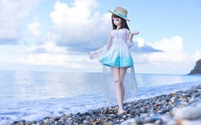 Picture sea, pebbles, doll, hat