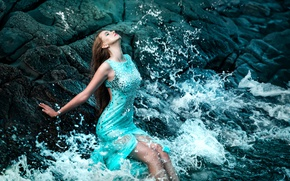 Picture sea, foam, girl, shore, wet, makeup, figure, dress, hairstyle, surf, brown hair, beautiful, sitting, in …