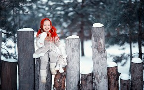 Picture winter, snow, joy, smile, mood, toy, girl, logs, shawl, bagel, sheepskin