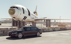 Picture the plane, car, the airfield, BMW 7