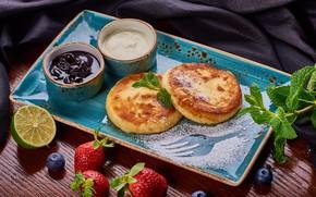 Picture lemon, strawberry, jam, blueberries, sour cream, cheesecakes