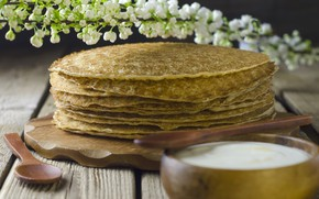 Picture branch, pancakes, sour cream