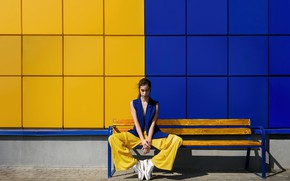 Picture blue, yellow, wall, bench, yellow and blue