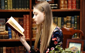 Picture girl, face, hair, book, library, reads