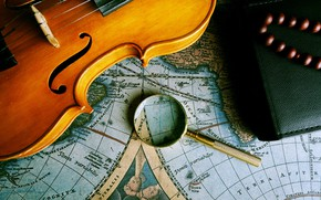Picture map, violin, magnifying glass