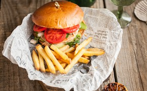 Picture tomatoes, hamburger, roll, French fries