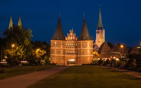Picture trees, night, lights, lawn, home, Germany, lights, track, monument, tower, architecture, Holstentor, Luebeck, The Holstein ...