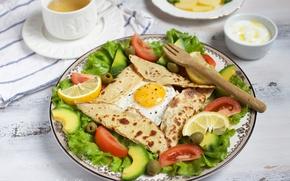 Picture lemon, scrambled eggs, tomato, olives, salad, avocado, pita