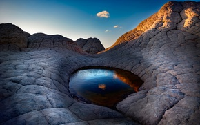 Picture the sky, water, stones, cloud, eye of the Cyclops