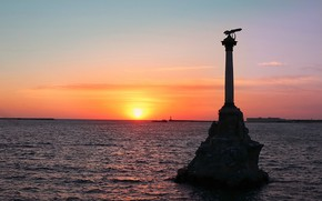 Picture the sky, the evening, the black sea, monument to the scuttled ships