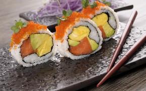 Picture sticks, caviar, sushi, avocado, salmon, omelette