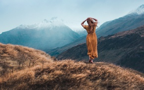 Picture autumn, the sky, grass, girl, snow, mountains, pose, fog, mood, the wind, hills, hair, tops, …