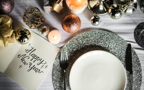 Picture the inscription, new year, candle, sequins, plate, knife, plug