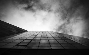 Picture the sky, clouds, the plane, the building, Windows, skyscraper, black and white