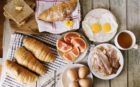 Picture eggs, bread, citrus, tablecloth, bacon, croissants