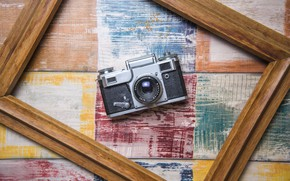 Picture frame, the camera, camera, wooden background, frame