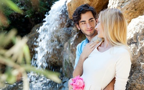 Picture girl, love, flowers, stones, waterfall, bouquet, blonde, pair, guy