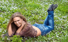 Picture grass, girl, flowers, smile, mood, jeans, hairstyle, lies, blouse, cute, brown hair, on earth