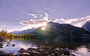 Picture autumn, forest, the sky, the sun, clouds, rays, trees, mountains, lake, stones, Wyoming, USA