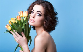 Picture look, girl, flowers, blue, background, bouquet, makeup, brunette, hairstyle, tulips, beauty, keeps