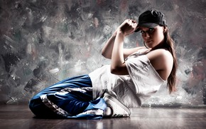 Picture girl, pose, background, wall, flexibility, dance, t-shirt, cap, brown hair, on the floor, sneakers, pants