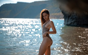 Wallpaper sea, swimsuit, the sun, pose, glare, rocks, shore, model, makeup, figure, slim, hairstyle, brown hair, ...