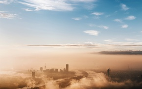 Picture the sky, the city, fog