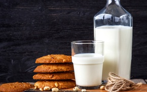 Picture glass, milk, cookies, book, nuts, milk, cookies