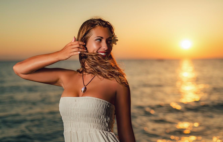 Photo wallpaper sea, the sky, the sun, sunset, pose, smile, the wind, the evening, makeup, dress, horizon, ...