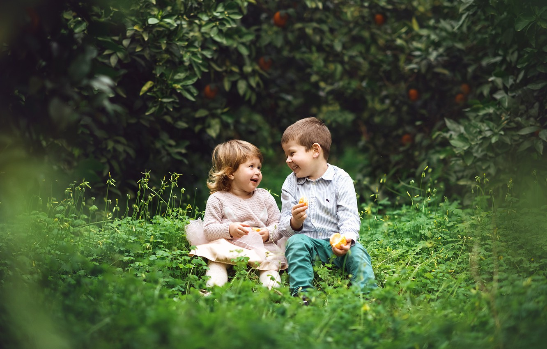 Photo wallpaper grass, children, orange, laughter, boy, girl