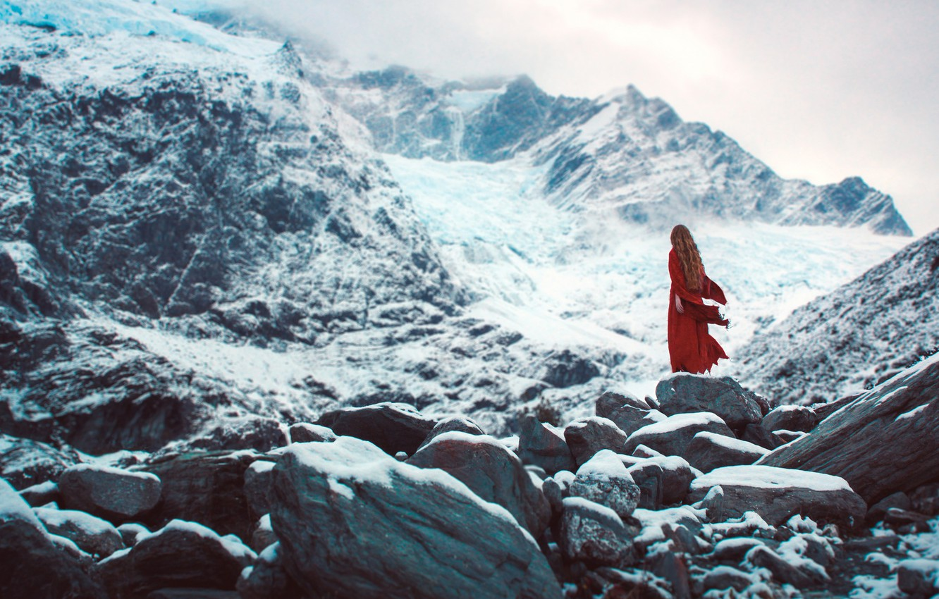 Photo wallpaper cold, winter, girl, snow, mountains, fog, loneliness, stones, overcast, mood, rocks, red, hair, back, the …