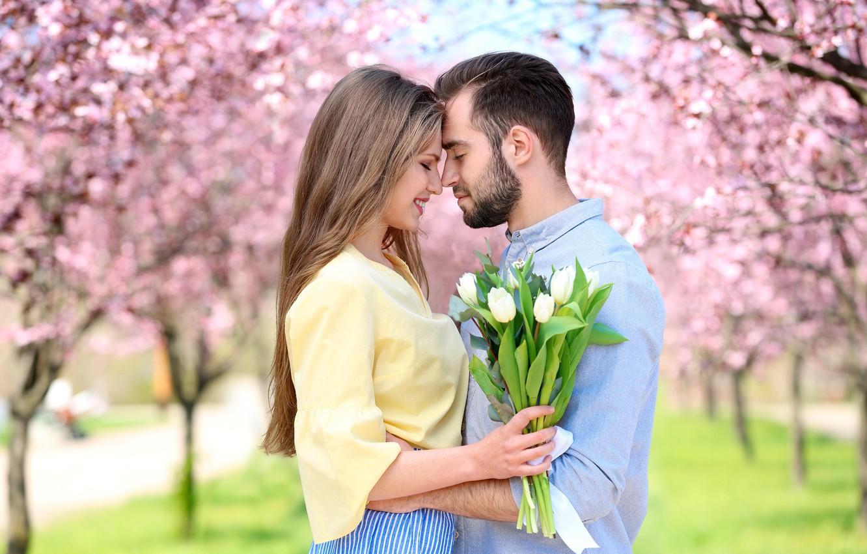 Photo wallpaper girl, trees, flowers, Park, bouquet, spring, pair, tulips, guy, flowering, lovers, bokeh