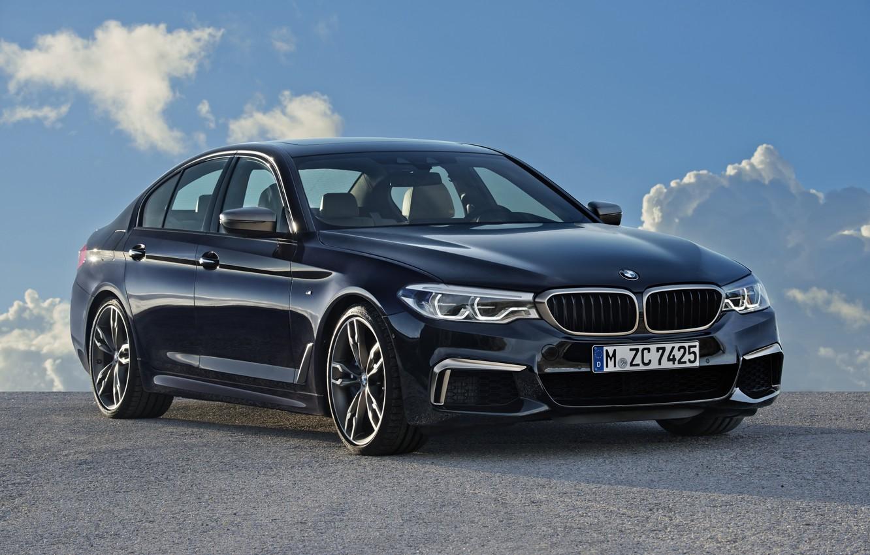 Photo wallpaper the sky, clouds, black, BMW, Parking, sedan, 5, four-door, 2017, 5-series, G30, M550i xDrive, 462 …