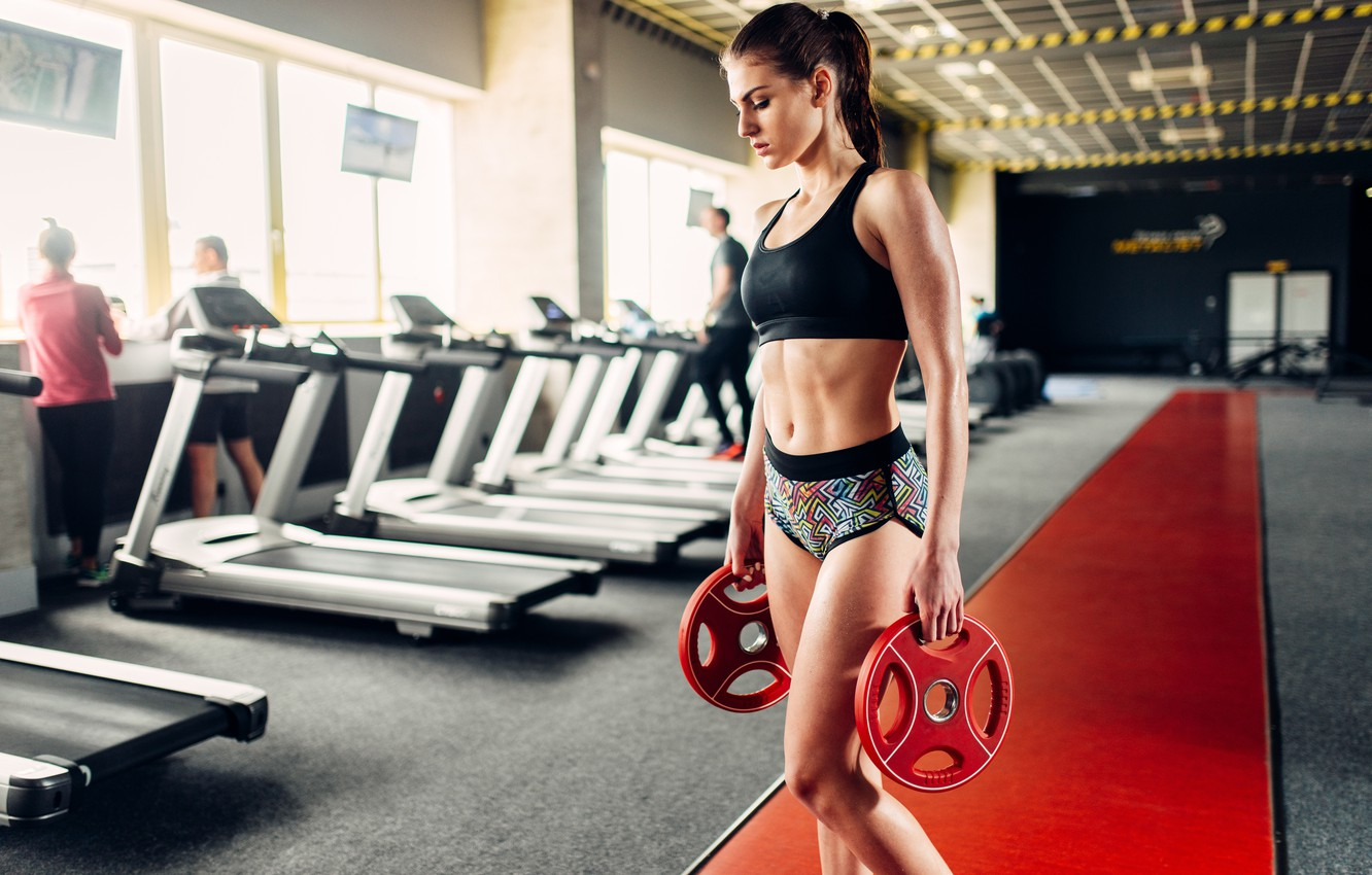 Photo wallpaper girl, sport, figure, slim, brunette, hairstyle, track, shorts, sports, topic, fitness, t-shirt, iron, the gym, …