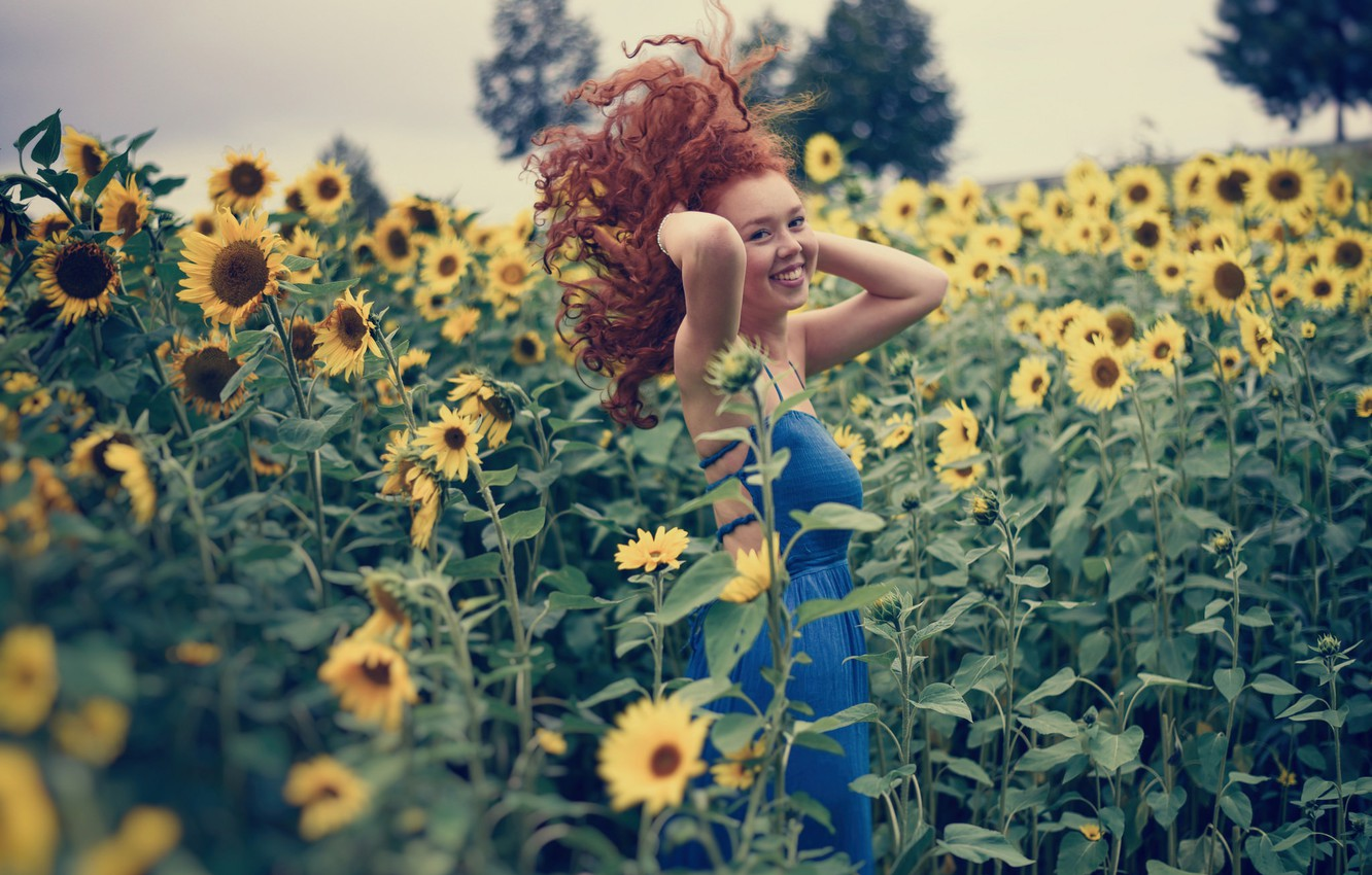 Photo wallpaper field, girl, sunflowers, smile, mood, hair, red, curls, redhead