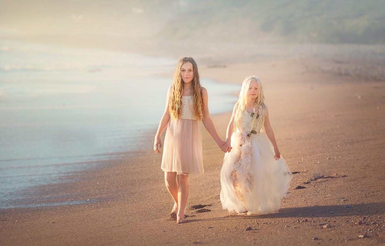 Photo wallpaper sand, shore, dresses, two girls