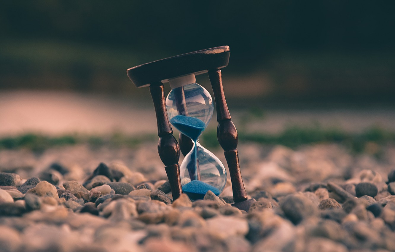 Photo wallpaper sand, stones, hourglass