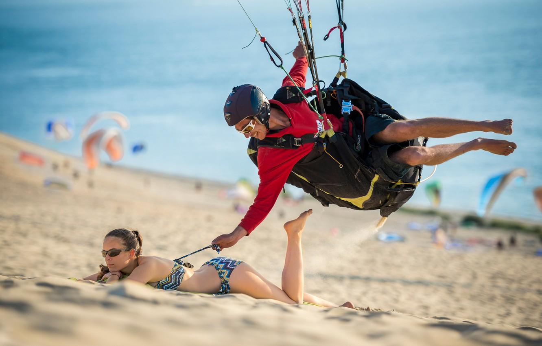Photo wallpaper Girl, sport, beach, woman, man, boy, sand, funny, situation, bikini, smiling, humor, paragliding