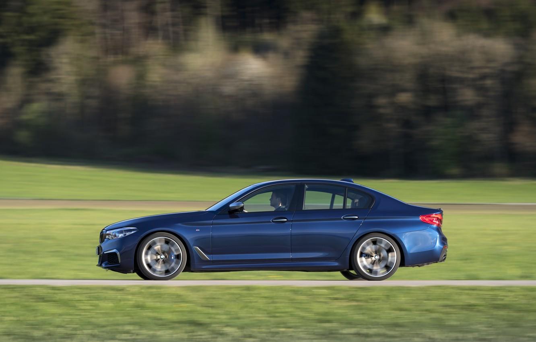 Photo wallpaper road, field, forest, grass, movement, BMW, profile, sedan, 5, dark blue, 2017, 5-series, G30, M550i …