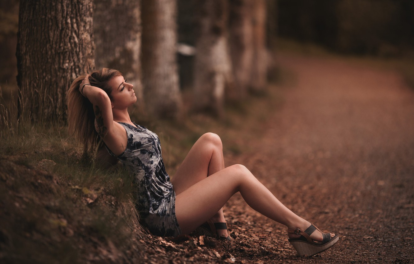 Photo wallpaper road, forest, girl, trees, pose, makeup, figure, dress, tattoo, hairstyle, shoes, brown hair, legs, beautiful, …