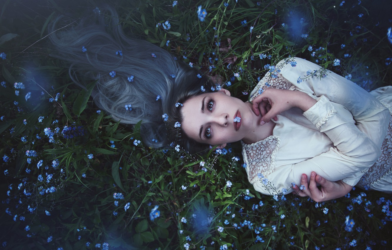 Photo wallpaper look, girl, flowers, face, pose, youth, glade, hair, portrait, spring, hands, dress, meadow, lies, long, ...