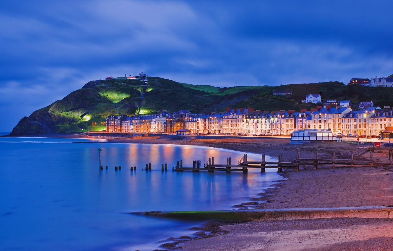 Photo wallpaper sea, night, lights, shore, mountain, home, promenade, Wales, Aberystwyth