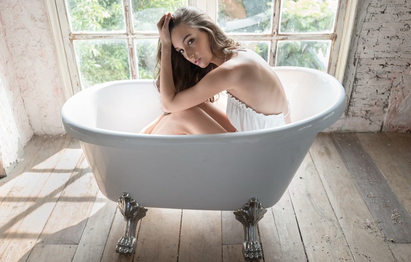 Monica shows off nude bathtub pose while